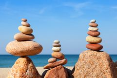 Rock zen pyramid of colorful pebbles on a beach on the background of the sea. Concept of balance, harmony and meditation.  royalty free stock photography