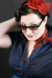 Rockabilly fashion. Portrait of a young girl dressed in Rockabilly fashion Stock Image