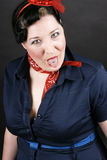 Rockabilly fashion. Portrait of an angry girl dressed in Rockabilly fashion Stock Photography