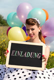 Rockabilly Girl holding a board with word invitation, concept Pa Stock Photos