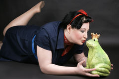 Rockabilly girl in love. Rockabilly girl deeply in love with her frog shaped prince Royalty Free Stock Photography