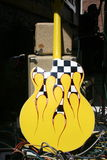 Rockabilly Guitar. Yellow rockabilly guitar with black and white checker flames Royalty Free Stock Photos