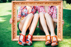 Rockabilly hen-party in park. Feet of girls in the picture frame Royalty Free Stock Photos