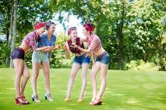 Rockabilly hen-party in park stock photo