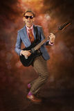 Rockabilly man playing the guitar Royalty Free Stock Images