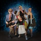 Rockabilly musikerfamilj Fotografering för Bildbyråer
