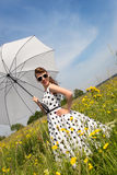 Rockabilly or Pin up Girl with a Petticoat dress and a umbrella Royalty Free Stock Photo
