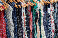 Rockabilly polka dot dresses. Colorful Rockabilly polka dot dresses on hangers display Royalty Free Stock Photo