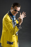 Rockabilly singer from 1950s in yellow jacket. Retro style rockabilly singer from 1950s in yellow jacket Stock Photos