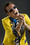 Rockabilly singer from 1950s in yellow jacket. Retro style rockabilly singer from 1950s in yellow jacket Royalty Free Stock Images