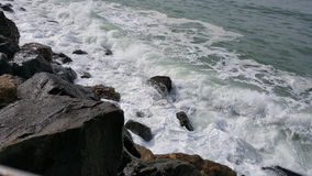 Rockaway Beach, Pacifica, California. View of the Pacific Ocean crashing on the rocks at Rockaway Beach, Pacifica, California Royalty Free Stock Image