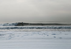 Rockaway ripper at snow covered Rockaway beach Stock Image