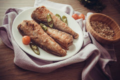 Rockcod on plate. Fried shad with chilli, australian fish Royalty Free Stock Image