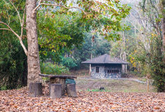 The rocked house for camping with wooden table and chairs Royalty Free Stock Photography