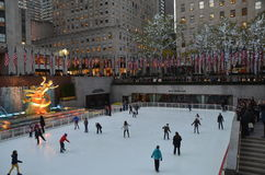 Rockefeller Center Ice skaters and tourists, NYC Royalty Free Stock Images