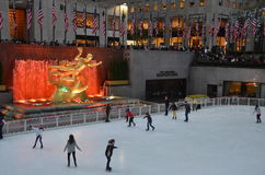 Rockefeller Center Ice skaters and tourists, NYC Royalty Free Stock Image