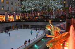 Rockefeller Center Ice skaters and tourists, NYC Royalty Free Stock Photo
