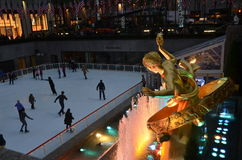 Rockefeller Center Ice skaters and tourists, NYC Stock Photography