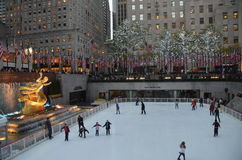 Rockefeller Center Ice skaters and tourists, NYC Stock Photos