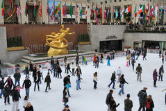 Rockefeller Center Ice Skating. People enjoying Rockefeller Center Ice Skating in New York City Royalty Free Stock Photography