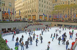 Rockefeller Center Ice Skating Rink. People enjoy ice skating at  Rockefeller Ice Rink in New York City Royalty Free Stock Photography