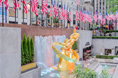 Rockefeller Center, New York. NEW YORK - CIRCA MAY 2013: The Statue of Prometheus above the ice rink at the Rockefeller Center, New York City, circa May 2013. It Stock Photo