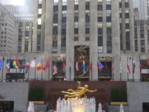 Rockefeller Center in New York City. NEW YORK - JULY 17: Statue of Prometheus above the ice rink at the Rockefeller Center on July 17, 2013 in Manhattan New York Royalty Free Stock Image