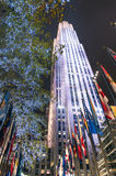 Rockefeller Center by night with international flags and lighting decorations - New York Royalty Free Stock Photography