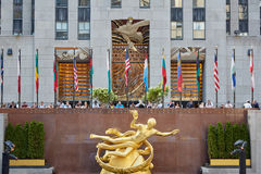 Rockefeller Center with Prometheus statue, New York. NEW YORK - SEPTEMBER 12: Rockefeller Center with golden Prometheus statue and people on September 12th, 2017 Royalty Free Stock Images