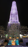 Rockefeller Center skating rink and Christmas tree by night. New York, USA Stock Images