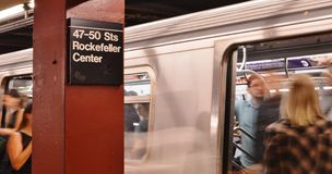 Rockefeller Center Subway with People Entering Train royalty free stock photos