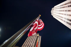 Rockefeller Center  with US flag Stock Images