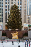 Rockefeller Ice Skate Ring New York City. The Rockefeller Ice skate ring, a large christmas tree and the golden Prometheus Statue Royalty Free Stock Photos