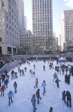 Rockefeller Square with snowy ice skating rink and Christmas tree in mid-town Manhattan, NY Royalty Free Stock Photo