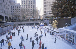 Rockefeller Square with snowy ice skating rink and Christmas tree in mid-town Manhattan, NY Stock Photography