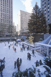 Rockefeller Square with snowy ice skating rink and Christmas tree in mid-town Manhattan, NY Royalty Free Stock Photos