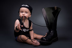 Rocker-baby. Dark portrait of  rocker-baby on a black background Royalty Free Stock Image