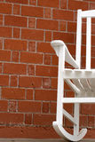 Rocker and brick. White rocker against red brick royalty free stock images