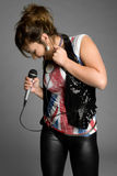 Rocker Chic. Beautiful teen rocker chic singing royalty free stock photo