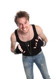 Rocker doing the heavy metal sign Stock Images