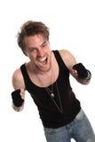 Rocker dude με τις αυξημένες πυγμές στοκ φωτογραφία με δικαίωμα ελεύθερης χρήσης