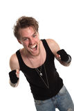 Rocker dude with raised fists. Wearing a tank top and jewellry. White background Royalty Free Stock Photography