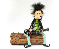 Rocker dwarf playing the guitar Royalty Free Stock Photos
