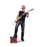 Rocker. With electrical guitar and guitar combo stock image