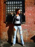 Rocker Girl. A punk rock girl walking behind a building Stock Images
