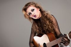 Rocker girl with acoustic guitar Royalty Free Stock Photos
