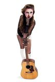 Rocker girl with acoustic guitar Royalty Free Stock Images