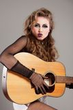 Rocker girl with acoustic guitar Stock Photography