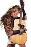 Rocker girl with acoustic guitar Stock Photos