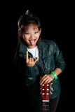 Rocker girl with a guitar. Rocker girl shows tongue and horns with his fingers Royalty Free Stock Images